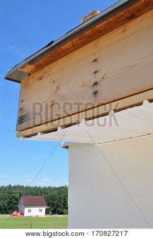 Soffit Board and Fascia Board Installation Repair. Roofing Construction.