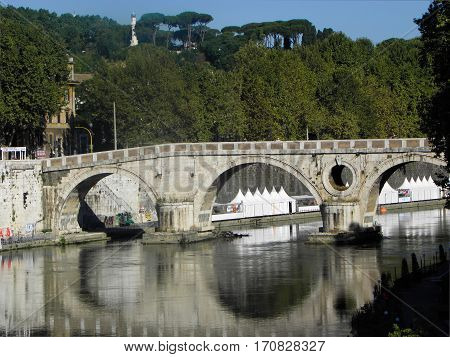 reflections in the Tiber from sisto bridge in rome