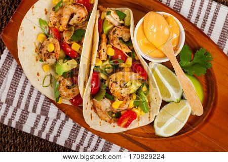 Shrimp Tacos with Corn and Avocado Salsa. Selective focus.