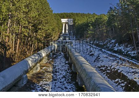 Water pipeline transporting water down to a valley accumulation station in wintertime, Pancharevo, Bulgaria