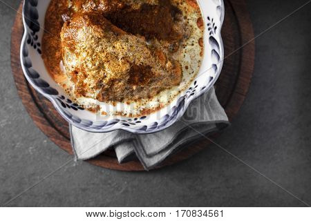 Butter chicken in a bowl with wavy edges on a napkin horizontal