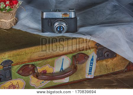 Vintage photo camera and travel a bag