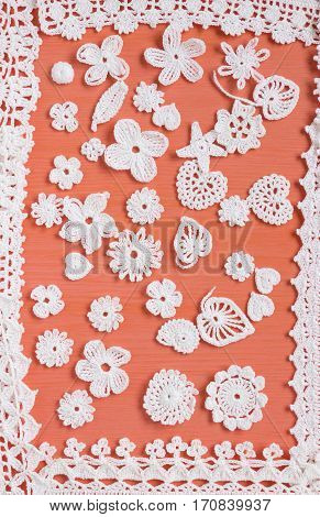 Handmade white crochet frame pattern knitting sewing. Homemade colorful backdrop. Mori Girl lace. Creative craft needlework