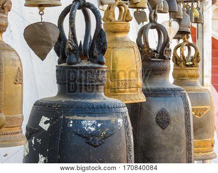 Praying bells in the Wat Saket Temple. Buddhist Temple Wat Saket or Golden mount, Bangkok, Thailand. Selective focus
