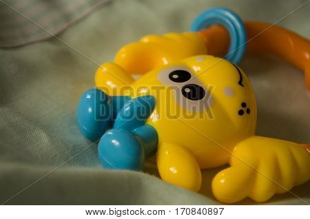 Childrens toys. Beanbag yellow color on the bed
