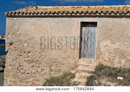 Old wooden door in a brick wall Mallorca
