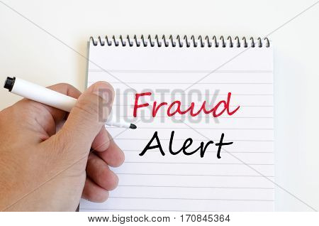 Fraud alert text concept write on notebook