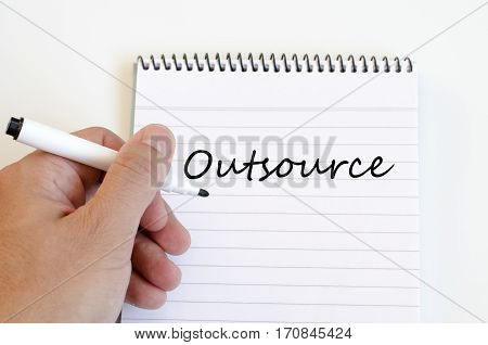 Outsource text concept write on notebook .