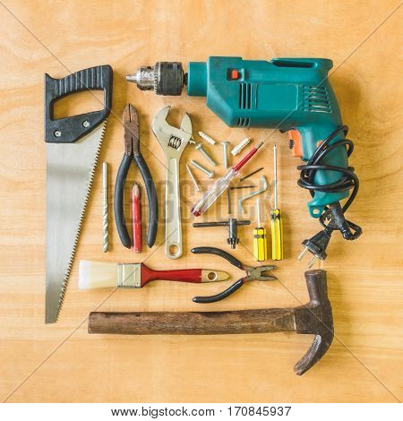 Set Of Different Work Tools On Wooden Table Background.