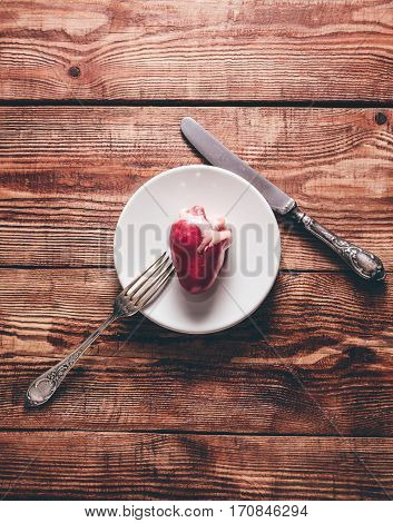Small Heart on White Plate with Silverware