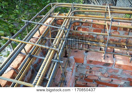 Reinforcement corner concrete bars with wire rod. Brickwork with Iron Bars for House Construction.