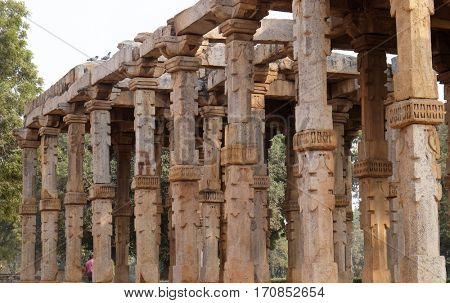 DELHI, INDIA - FEBRUARY 13 : Columns with stone carving in courtyard of Quwwat-Ul-Islam mosque, Qutab Minar complex, Delhi, India on February, 13, 2016.