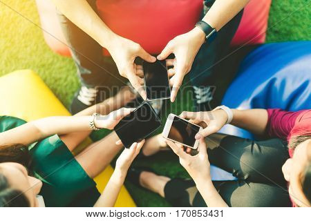 Group of three young people using smartphones together modern lifestyle or communication technology gadget concept