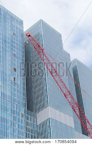 ROTTERDAM NETHERLANDS - MAY 14 2016: Construction crane in front of the famous skyscraper
