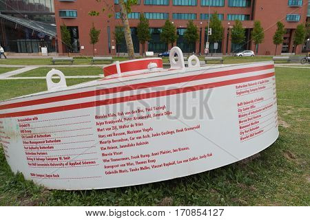 ROTTERDAM NETHERLANDS - MAY 14 2016: Buoy with names of the contributors of the bobbling forest a collection of buoys with smal elm trees planted in them
