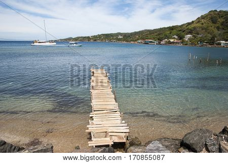 The view of wooden pier in Coxen Hole town on Roatan Island (Honduras).