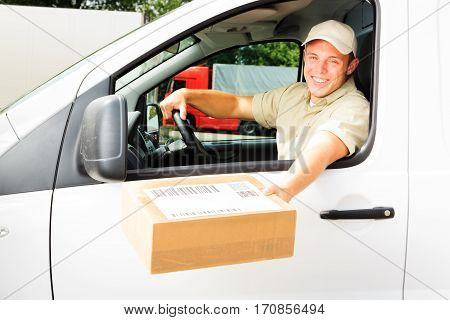 delivery boy handing you a parcel.  all barcodes on the parcel are generated by myself and contain no useful data.