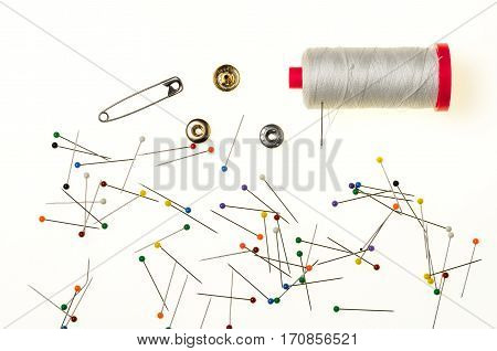 Background with a Multitude of Pins with the Head in Various Colors isolated in white