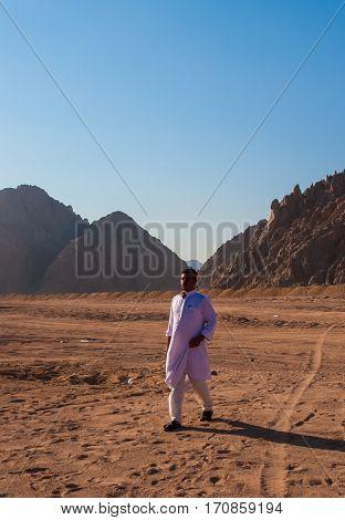 SHARM EL SHEIKH EGYPT - JULY 9 2009. Bedouin walking on desert