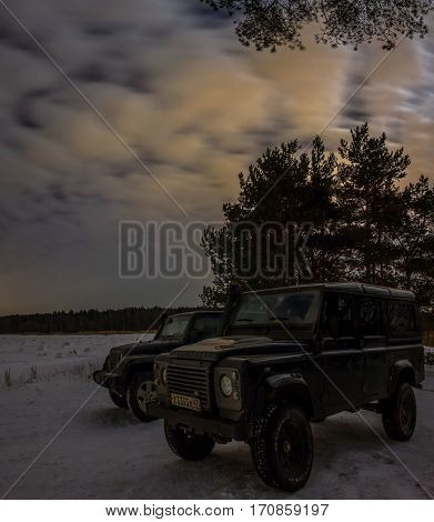 Leningrad region, Russia - February 04, 2017 Jeep Wrangler and Land Rover defender on the Gulf of Finland , Wrangler is a compact SUV produced by Chrysler