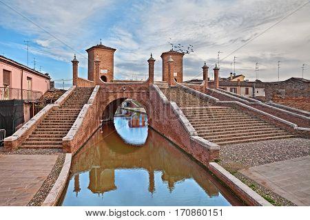 Comacchio, Ferrara, Emilia Romagna, Italy: the ancient bridge Trepponti, a famous five-way bridge in the old town known as the Little Venice