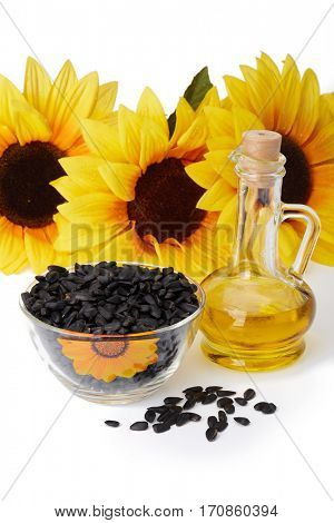 Sunflower, seed and vegetable oil in a bottle on a white background.