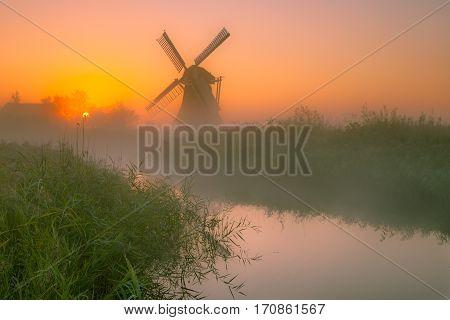 Dutch Windmill In A Wet Polder