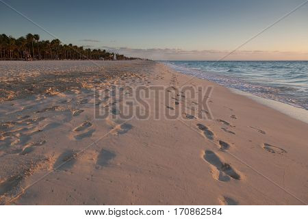 Early morning footprints on a Caribbean beach near Playa Del Carmen on the Yucatán Peninsula