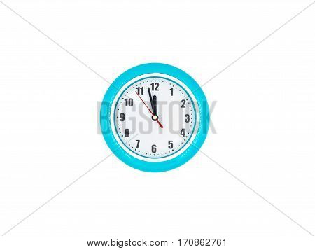 Blue wall clock on the white background twelve o'clock