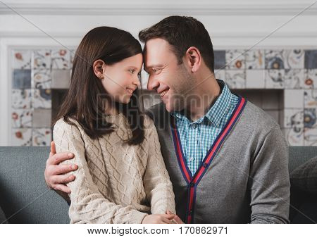 Family portrait of happy father and his daughter at home
