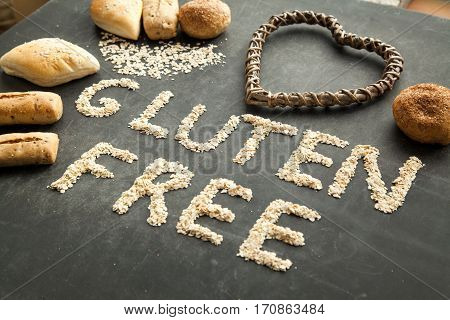 Gluten free bread for people that got special diet. Varios buns on black background health care concept.