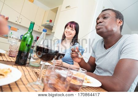 Multi ethnic group of friends having a dinner party