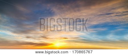 blue and orange sky with clouds at sunset