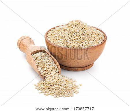 Real quinoa in a wooden bowl isolated on white background. Deep focus