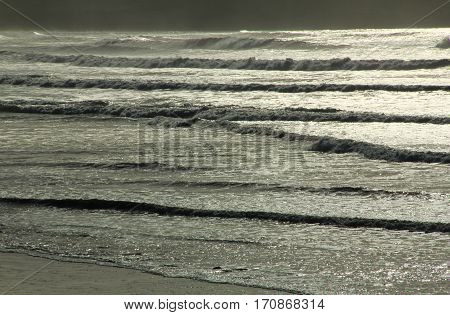 Waves at storm in the backlight Atlantic Ocean Plage de Kerloch Finistere Brittany France