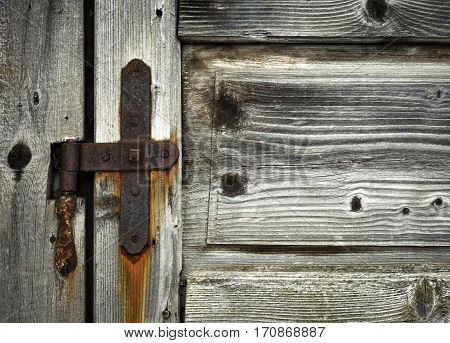 retro background detail of old wooden door hinge
