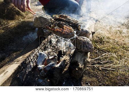 burnt-out fish barbecue outside picnic, lifestyle people concept close up
