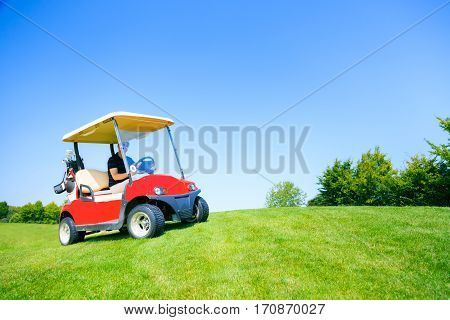 Adult man driving a golf cart, enjoying his favorite sport.
