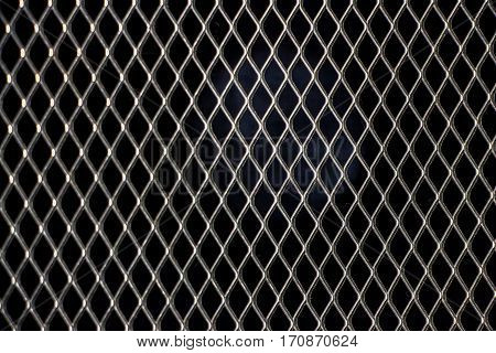 A metal grid. Abstract background texture of steel