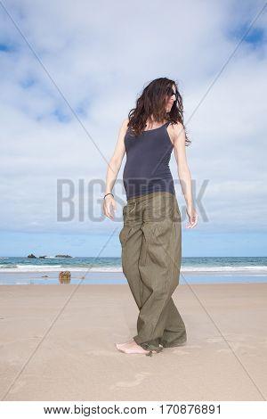 Grey Shirt Pregnant Walking At Beach