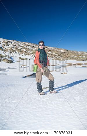 Trekking Woman Standing In Winter Snow