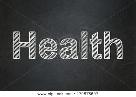 Healthcare concept: text Health on Black chalkboard background