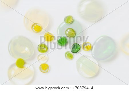 Colorful decorative glass stones close-up with reflection on white background . For beautiful modern background pattern wallpaper or banner design
