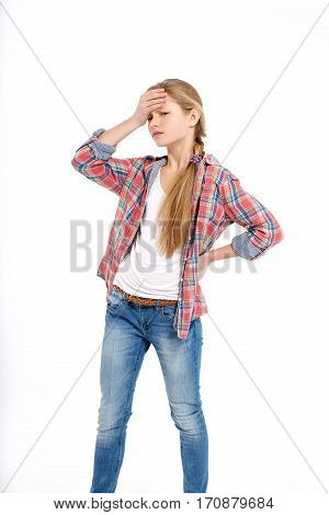 young teenage girl holding head with ache on white background