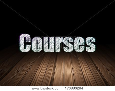 Education concept: Glowing text Courses in grunge dark room with Wooden Floor, black background