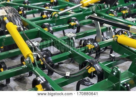 Closeup photo of an agricultural equipment in green