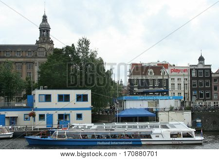Netherlands Amsterdam june 2016: Canal-boats sailing slowly trough th canals of Amsterdam