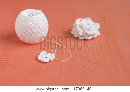 The beginning of handmade crocheted cotton organic doily flower and small crochet flower doiles. Needlework creative craft Mori Girl lace style
