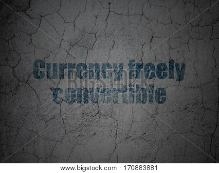 Banking concept: Blue Currency freely Convertible on grunge textured concrete wall background