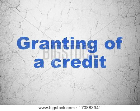 Currency concept: Blue Granting of A credit on textured concrete wall background